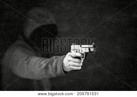 Ghostly figure with a gun in the dark