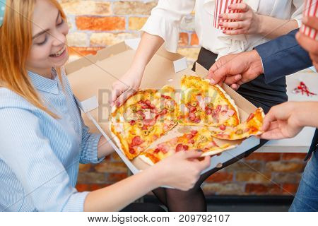 The ordered pizza in a close-up box is very appetizing on the desktop
