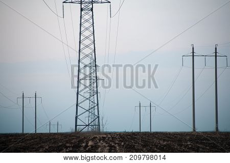 power lines Pylon and transmission power line in sunset