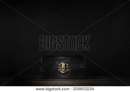 Old Closed Wooden Treasure Chest With Black Background