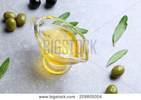 Gravy boat with olive oil on grunge table