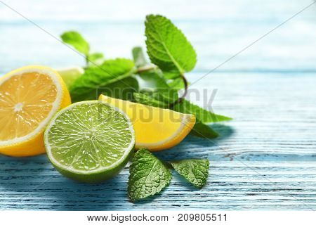 Composition with citrus fruits and mint on wooden background