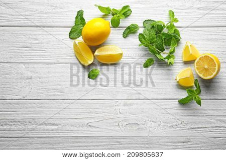 Mint and lemon on wooden background