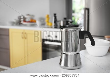 Coffee maker on table in modern kitchen