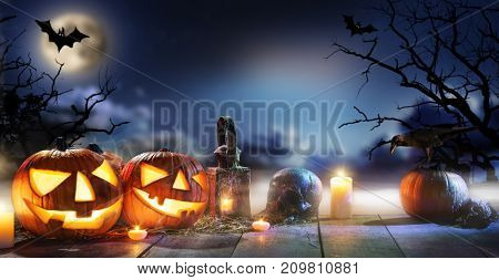 Spooky halloween pumpkins on wooden planks with dark horror background. Celebration theme, copyspace for text.