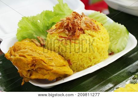 Chicken biryani with rice delicious and sauce