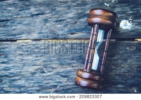 Hourglass time passing concept for business deadline urgency and running out of time