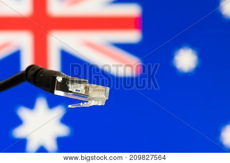 Ethernet cable with Australian  flag in the background symbolizing internet in Australia
