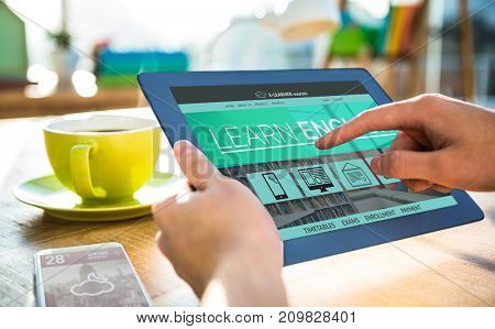 Vector 3D image of e-learning interface on screen against cropped image of hipster businessman using tablet