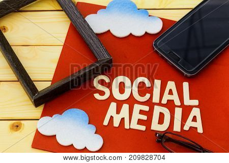 Social media concept with cloud,smartphone,spectacles and picture frame