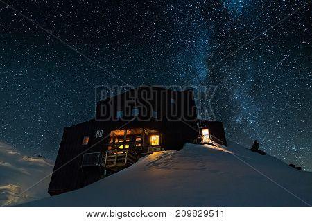 High-altitude refuge under the starry sky. Alps, France.