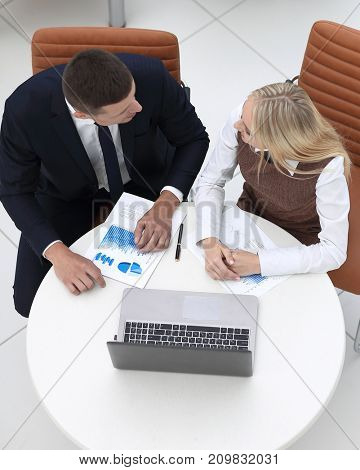 businessman and business woman discussing marketing scheme