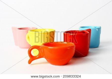 An image of colorful empty cup isolated on white background.