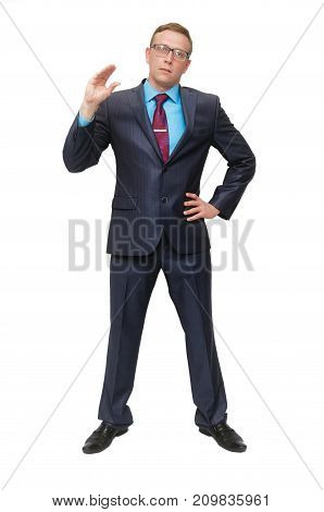 A business man in a suit and glasses is skeptical and shows a gesture of empty chatter isolated on white background. Talking lies. Strict boss