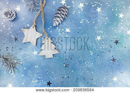 Wooden Christmas Decorations With Fir Cones On Blue Background