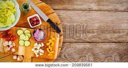 Overhead view of fresh chopped vegetables on wooden cutting board