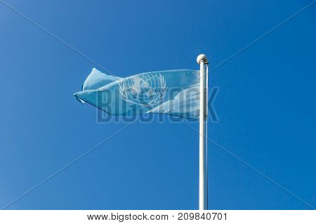 Busan, Republic Of Korea - September 12 2017: United Nations Un Flag Waving On Cloudless Blue Sky At