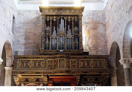 LUCCA, ITALY - JUNE 03: Organ in Basilica of San Frediano, Lucca, Tuscany, Italy on June 03, 2017.
