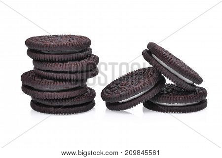 sandwich chocolate cookies with cream on white background