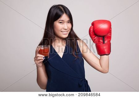Young Asian Woman With Tomato Juice And Boxing Glove.
