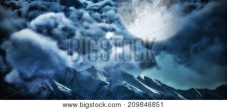 Digitally composite image of storm clouds  against snowy mountain range against clear blue sky