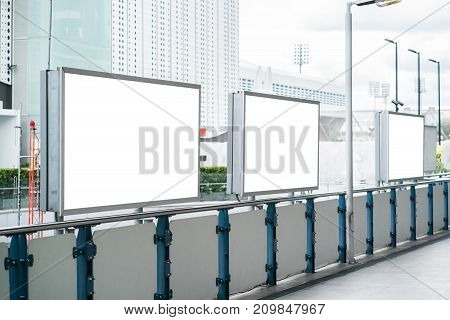 Blank pure white mock up or advertising billboard at the walkway of business area with clipping path