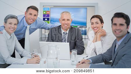 Business team looking at camera against digitally generated image of various video and icons displayed
