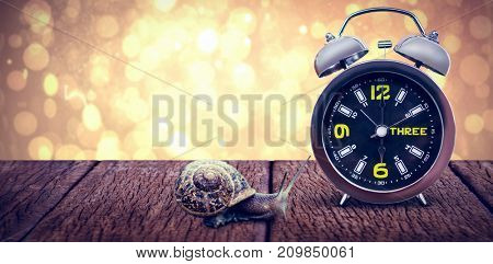 Close up of alarm clock against yellow abstract light spot design