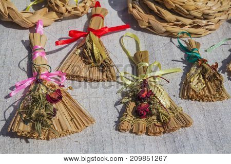 Straw doll charm handmade. The talisman of happiness, health and vitality. Manufactures of straw sold at the fair. Traditional Belarusian art.