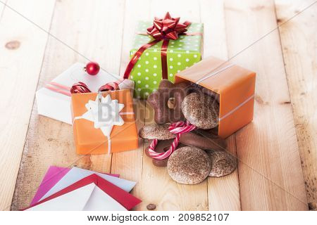 Gifts and sweets spread on table - Colorful gift boxes and gingerbread spread on wooden table