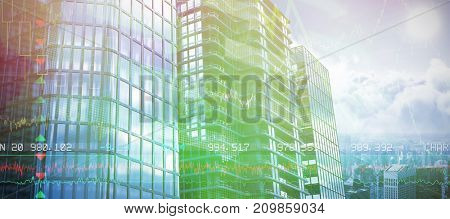 3d image of glass buildings against stocks and shares