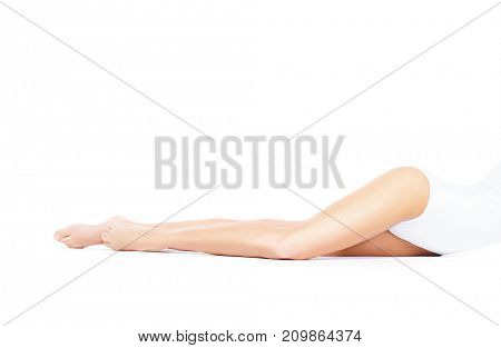 Fit and sporty girl in white underwear. Beautiful and healthy woman posing over isolated white background. Sport, fitness, diet, weight loss and healthcare concept.