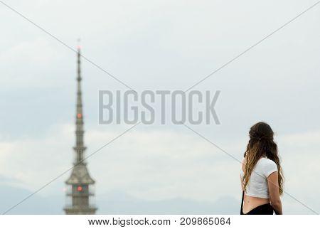 Tourist looking at turin cityscape with mole antonelliana