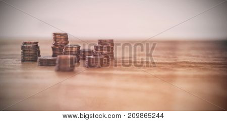 Stack of coins on table against white background