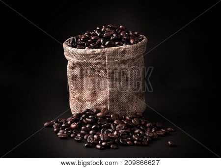 seed coffee bean dark with blurry background