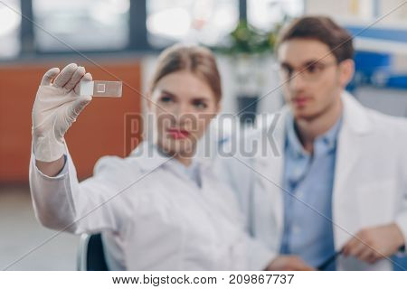 Chemists With Microscope Slide