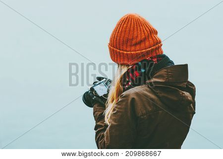 Woman photographer with photo camera foggy cold sea on background Travel Lifestyle concept adventure vacations outdoor