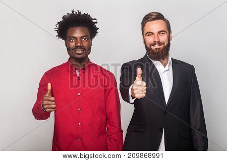 Well Dressed Businessman Showing At Camera Like Sign And Smiling. Focus On Face.