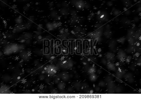 christmas snowflakes falling snow from top winter holiday xmas event on black background
