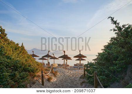 Tropical Sunset On A Resort Beach