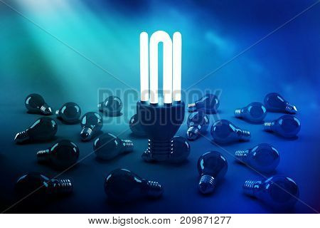 High angle view of illuminated energy efficient lightbulb over bulbs on gray background