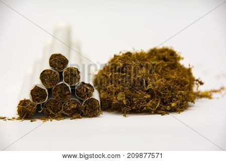 cigarette and tobacco on white background composition photography