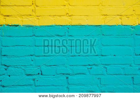 brick wall painted wit color. saturated color.