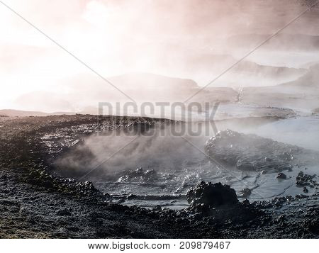 Morning at Sol de manana geyser with mud pots, Bolivian Andean Altiplano, Bolivia, South America.