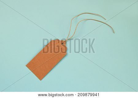 Brown Blank Paper Price Tag Or Label Set On The Blue Background, Top View.