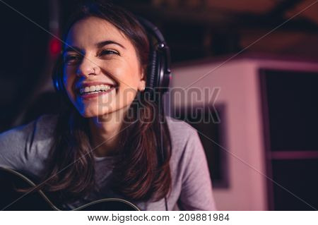 Woman Singing A Song In Recording Studio