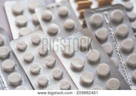 Medicine tablets background, selective focus, copy space