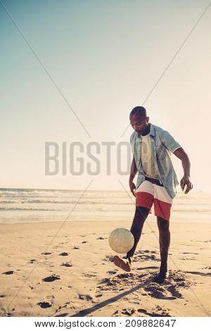 African Man Playing With Football