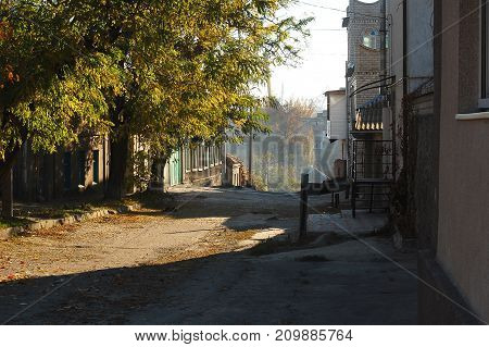 Quiet Autumn Street In A Small South Town. Concept Of Autumn In A Small Town