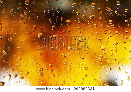 Water Backgrounds With Water Drops. The Fire Behind The Wet Glass.